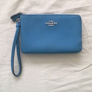 Blue Coach wristlet. Never been used.